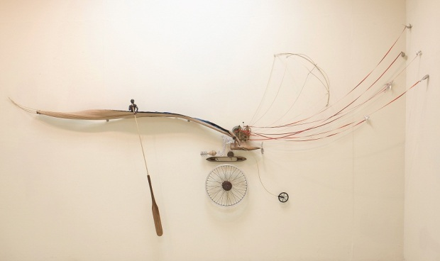 Jasmine Thomas-Girvan - Dreaming Backwards, mixed media (bronze, wood, found objects, feathers), 365.7 x 7.6 cm